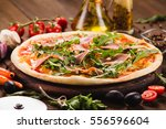 italian pizza with chicken ... | Shutterstock . vector #556596604