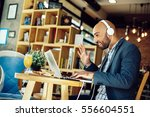 businessman in a cafe at...   Shutterstock . vector #556604551