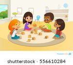 children sit in circle on round ... | Shutterstock .eps vector #556610284