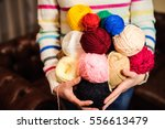 young pretty woman holding many ... | Shutterstock . vector #556613479