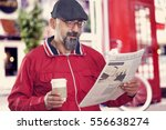 middle aged man reading... | Shutterstock . vector #556638274