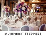 round dinner table decorated... | Shutterstock . vector #556644895