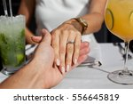close up couple hands in... | Shutterstock . vector #556645819