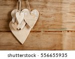 wood hearts on old wood... | Shutterstock . vector #556655935