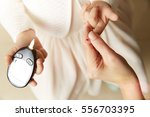 young girl testing blood sugar...   Shutterstock . vector #556703395