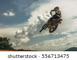 motocross rider jumping in the... | Shutterstock . vector #556713475