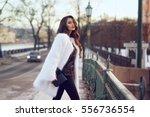 young beautiful stylish woman... | Shutterstock . vector #556736554