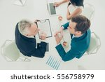 top view of two businessmen in... | Shutterstock . vector #556758979
