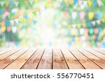 empty wooden table with party... | Shutterstock . vector #556770451