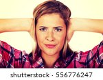 young woman covering her ears.... | Shutterstock . vector #556776247