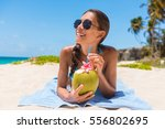 sunglasses beach woman drinking ... | Shutterstock . vector #556802695