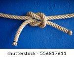Ship Rope Knot On Blue Concret...