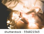 woman with lights in hands   Shutterstock . vector #556821565