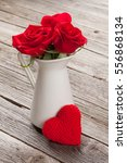 Red Rose Flowers In Pitcher An...