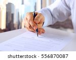 businessman is signing a... | Shutterstock . vector #556870087
