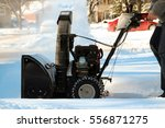 a man cleans snow from... | Shutterstock . vector #556871275