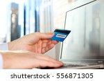 business man entering data of a ... | Shutterstock . vector #556871305