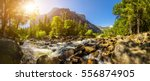 stormy mountain river panorama | Shutterstock . vector #556874905