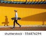 young skater boy walking... | Shutterstock . vector #556876294
