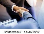 businessman shaking hands to... | Shutterstock . vector #556896049