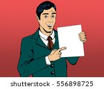vector business man pointing at ... | Shutterstock .eps vector #556898725