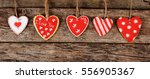 the hearts on wooden background.... | Shutterstock . vector #556905367