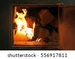 firewood burning in the stove   | Shutterstock . vector #556917811
