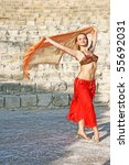 Beautiful belly  dancer on the ancient stairs of  Kourion amphitheatre in Cyprus. - stock photo