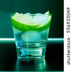 Small photo of St. Patrick's Day, Green Background. an alcoholic or non-alcoholic cocktail. bar, restaurant, mint, lime, lemon, alcoholic, non-alcoholic
