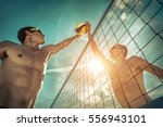 beach volleyball players in... | Shutterstock . vector #556943101
