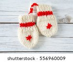 Knitted Baby Socks And Mittens