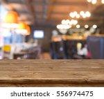 wooden table in front of... | Shutterstock . vector #556974475