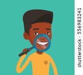 african american man examining... | Shutterstock .eps vector #556983241