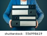 accountant holding document... | Shutterstock . vector #556998619