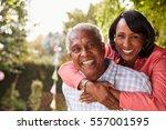 senior black couple piggyback... | Shutterstock . vector #557001595