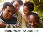 Small photo of Two adult black couples have fun piggybacking, close up