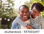 laughing young black couple... | Shutterstock . vector #557001697
