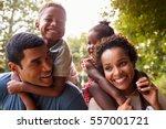 african american parents giving ... | Shutterstock . vector #557001721