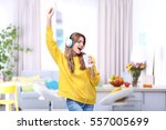beautiful young woman listening ... | Shutterstock . vector #557005699