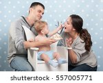 young happy family eating cake | Shutterstock . vector #557005771