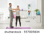 physiotherapist working with... | Shutterstock . vector #557005834