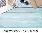 desk table with laptop  coffee... | Shutterstock . vector #557012605