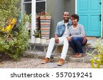 young couple sit looking to... | Shutterstock . vector #557019241