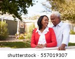 senior black couple standing... | Shutterstock . vector #557019307