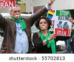 BERLIN - JUNE 19: Activists demonstrating against the killing of gay people at the Christopher Street Day Parade June 19, 2010 in Berlin, Germany. - stock photo