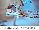 seamstress sews clothes....   Shutterstock . vector #557045431
