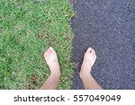 bare feet on the green grass... | Shutterstock . vector #557049049