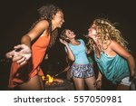 multicultural group of friends... | Shutterstock . vector #557050981
