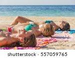 three girls sunbathing on the... | Shutterstock . vector #557059765