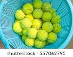 tennis ball in a basket of blue. | Shutterstock . vector #557062795